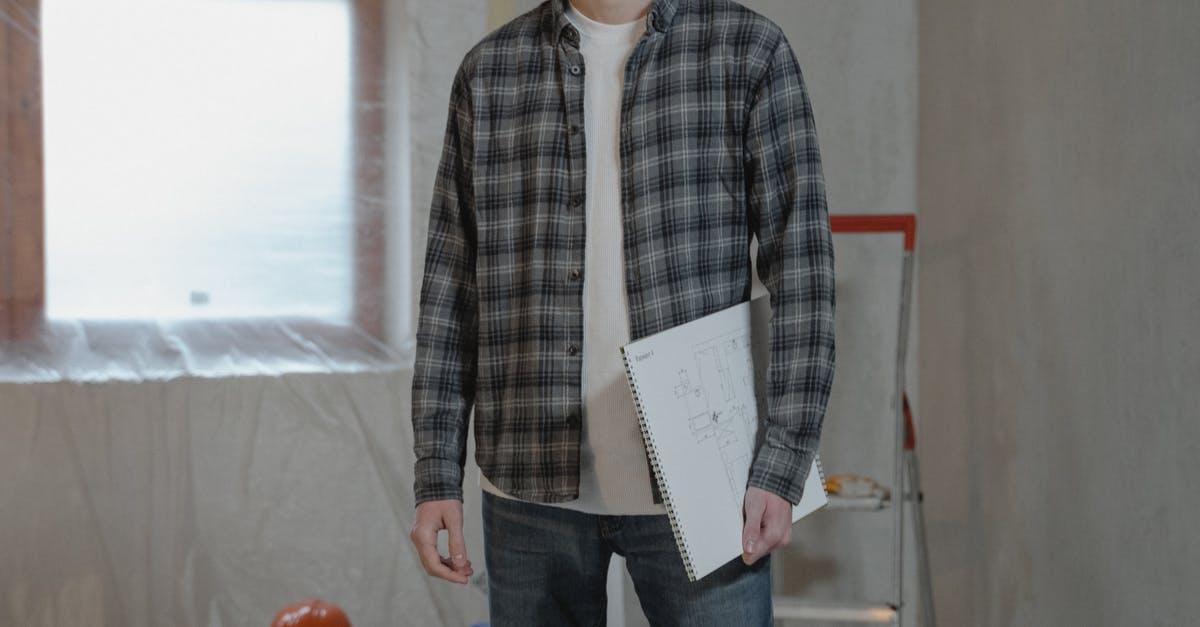 A man standing next to a knife
