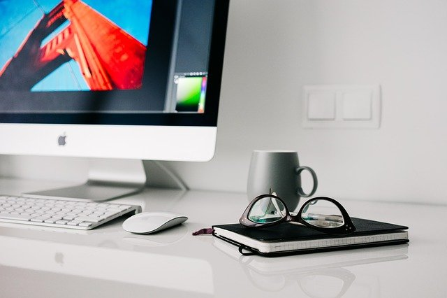 A desktop computer monitor sitting on top of a desk